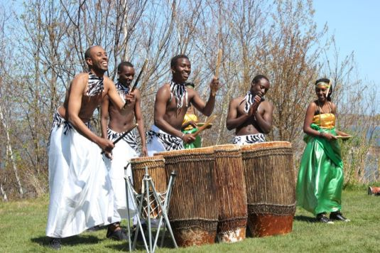 Abeza B'inganzo bringing their infectious smiles and powerful rhythms. Photo by Jessica Townsend