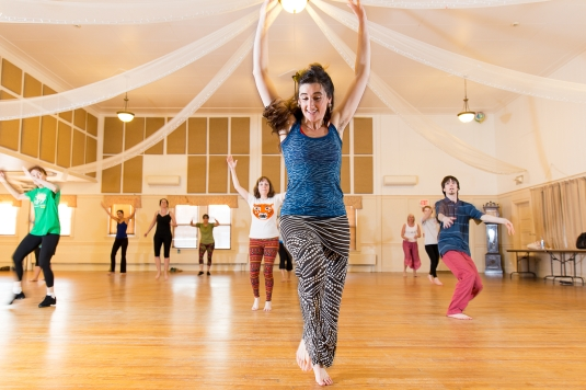 Instructor Marita Kennedy-Castro leads a class in West African inspired dancing Tuesday, April 7, at The Woodfords Club in Portland.